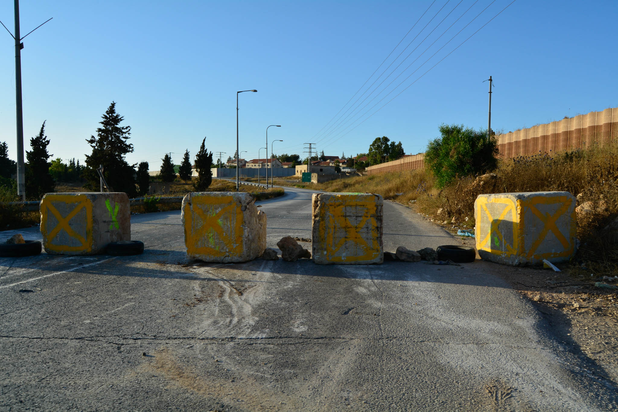 This the main road from Ramallah to Nablus. The previous day it was open and on this day it was closed for no apparent reason. Residents have to find alternative routes.