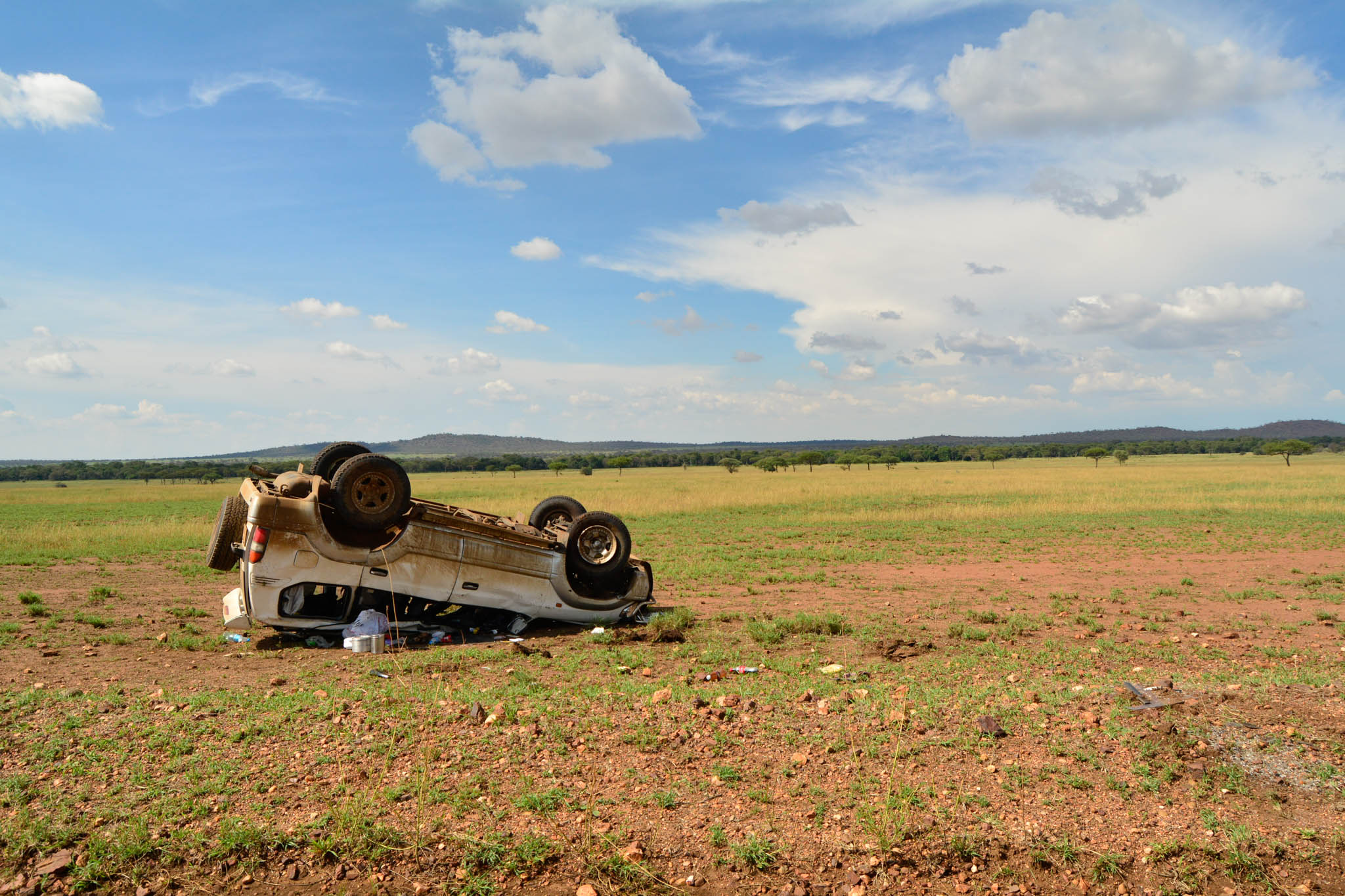 A vehicle overturned in the Serengeti. It looked like it may have happened a couple of days ago.